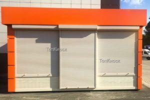 Торговый павильон утепленный с оранжевым рекламным фризом
